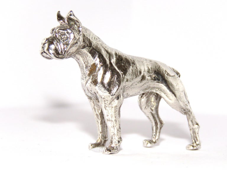 Solid silver boxer dog figurine, in very good vintage condition. Dimensions: Height 45 mm / 1,77 inches - Length from tip of tail to tip of nose 65 mm / 2.55 inches - Weight 56 grams / 1.80 troy ounces It  is stamped with the Silver Italian Mark 925