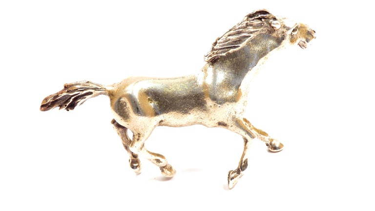 Solid silver horse in very good vintage condition. Dimensions: Height 48 mm / 1.889 inches - Length 66 mm / 2.598 inches - Weight 44 grams. It  is stamped with the Silver Italian Mark