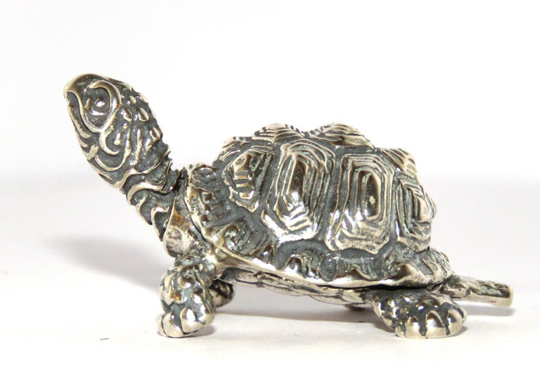 Solid silver turtle figurine, in very good vintage condition. Dimensions: Height 30 mm / 1.18 inches - Length 50 mm / 1.96 inches - Weight 31 grams / 0.99 troy ounces It  is stamped with the Silver Italian Mark 800 - 181VA - UGHETTI FRANCO VARESE