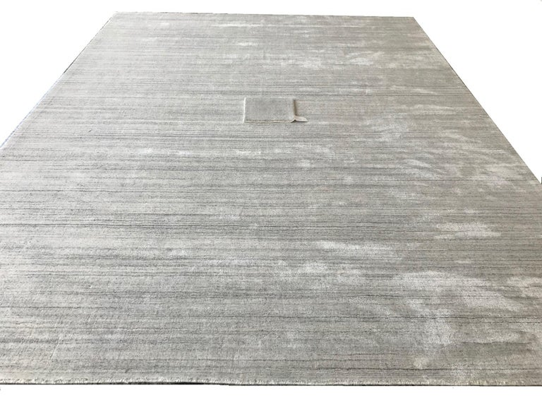 Industrial Modernist White Bamboo Silk Hand-Loomed Solid Rug with Silver Tone For Sale