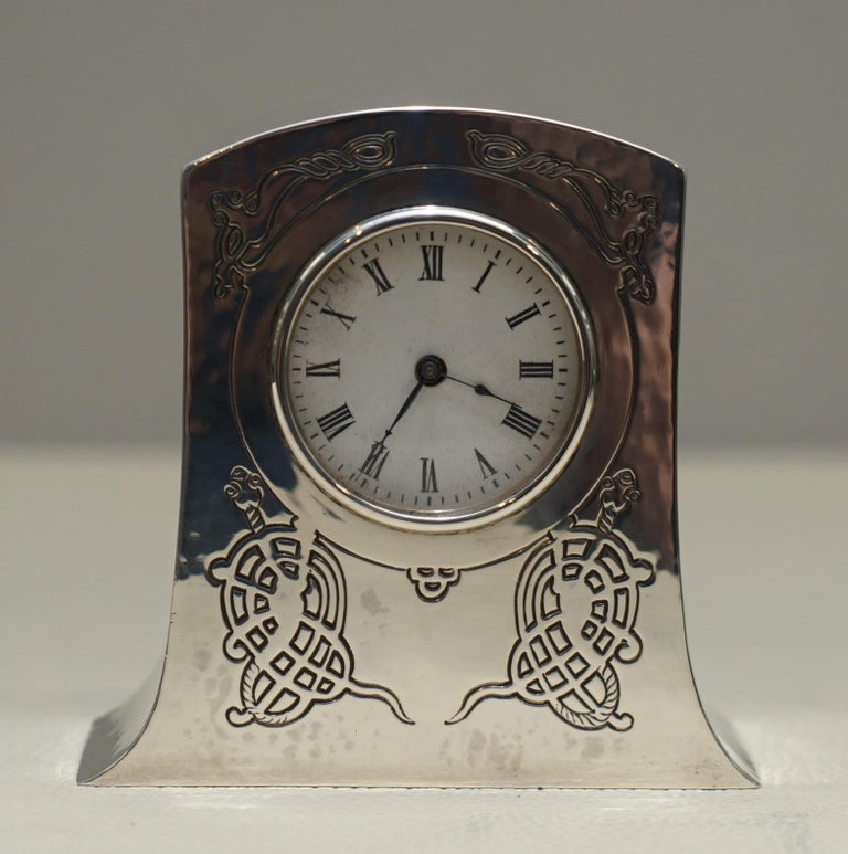 We are delighted to offer for sale this exceptionally rare and absolutely stunning fully hallmarked 1915 Liberty's London Sterling Silver miniature carriage clock made in the Tudric style   I have a few very high end Liberty's of London clocks,