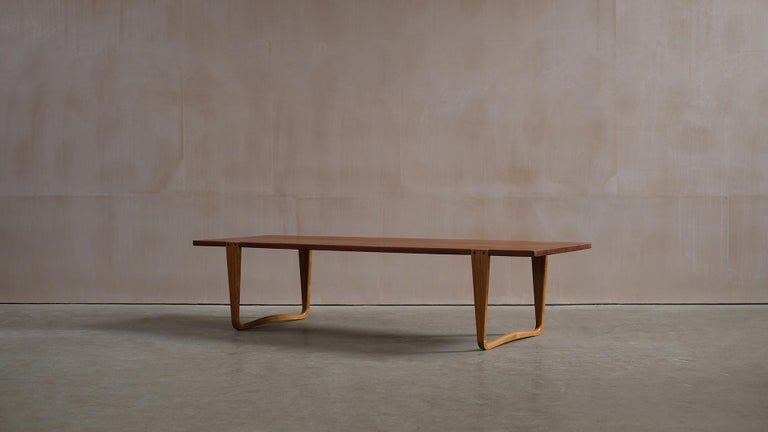 Ultra rare and beautiful large bench / coffee table designed by Michael Bloch for Nordisk Træ-Lamel, Denmark 1957. Staggeringly beautiful solid teak top with outstanding figuring and contrasting sculptural ash legs. A wonderful piece of classic high