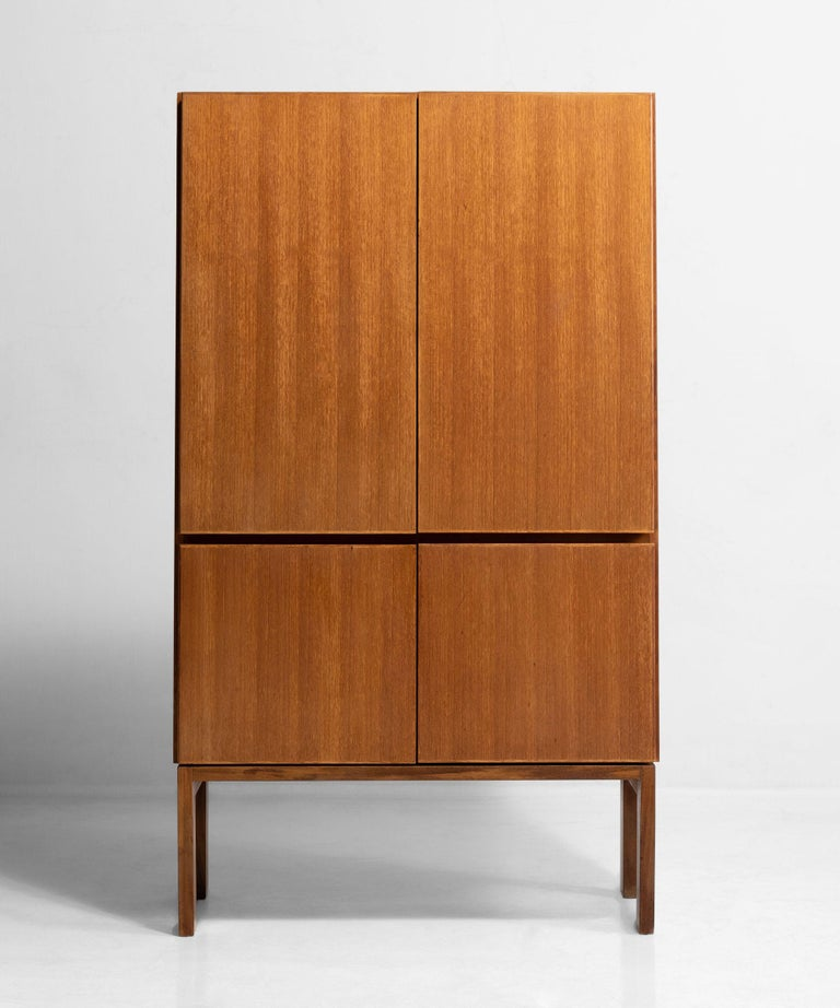 """Model """"GR69"""" four door cabinet with interior shelving on simple straight legs."""