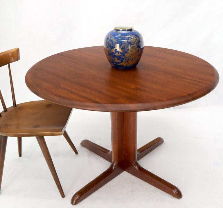 Danish Mid-Century Modern round solid teak dining table.