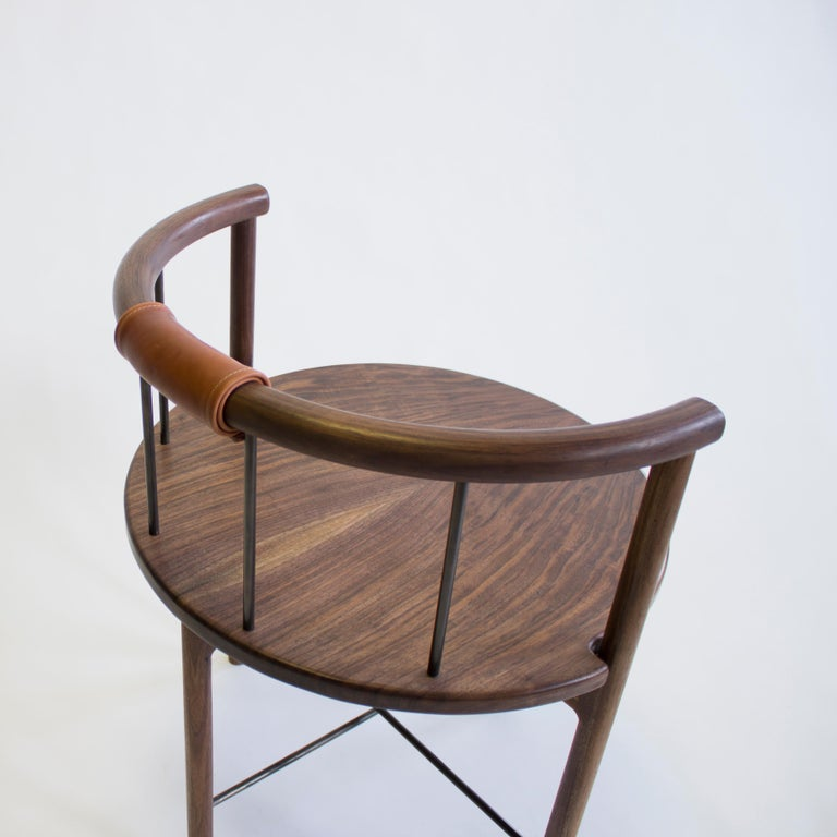 The Lloyd chair, by up-and-coming Baltimore-based design studio Crump & Kwash, is made from solid wood — seen here in walnut, but also available in white oak, blackened oak, and maple. The chair features a barrel back with brass, steel, or bronze