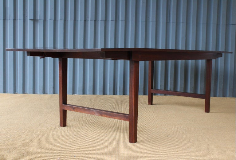 Solid walnut drop-leaf table that converts from a coffee table to a dining table. Recently refinished.