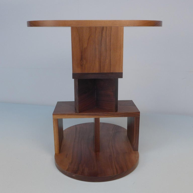 With a playful nod to Postmodern design, the double pyramid table by designer Michael Schoner transforms the side table into a tower-like sculpture with equally balanced proportions. This side table is handcrafted from solid walnut in the