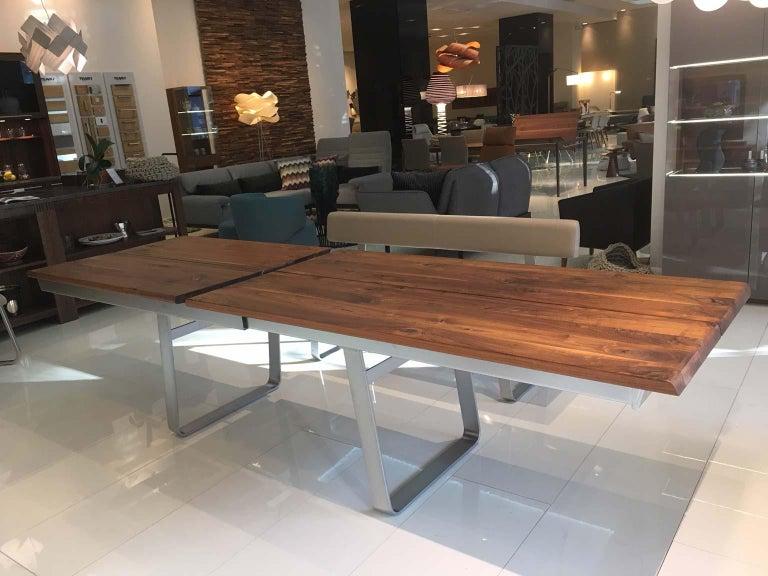 Austrian Solid Wild Walnut Wood Extending table Matt Chrome Skid Base For Sale