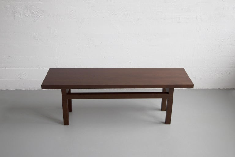 This contemporary bench is constructed of solid wood and made to order in our Brooklyn studio. Pictured in (darkened) walnut, the yarrow bench is accented with lap joint aprons and enlists group of slender timbers to visually elongate the
