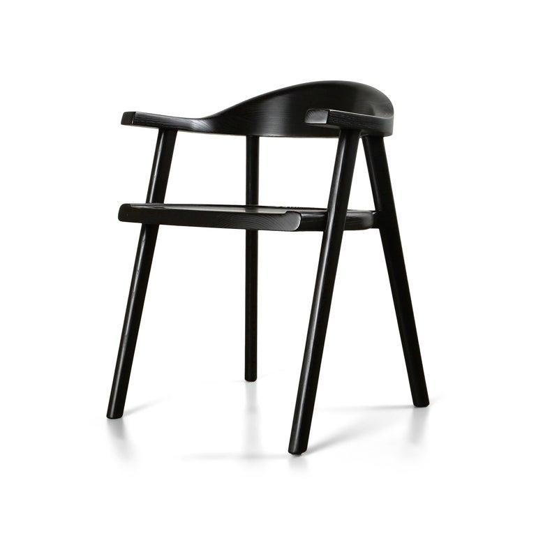 The solid wood Karve chair features soft curves and a contoured backrest exuding comfort and craftsmanship. The blackened finish accentuates the grain of the ash, beautiful from every angle.  Chairs are built to order, bespoke options always