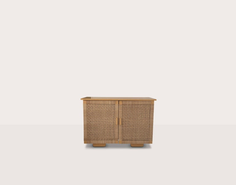 Designed by the American Bauhaus designer, Michael van Beuren in Mexico in circa 1940, this handmade, solid wood credenza is made with hand woven doors and his signature, distinctive Mid-Century Modern feet. Available in a variety of woods and