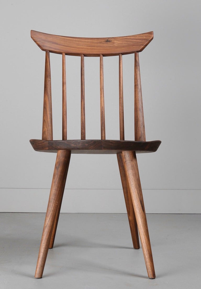 The Vände chair is a contemporary take on the classic Windsor chair. Hand-turned spindles feature wedged, mortice and tenon joinery for strength and aesthetic appeal.  The round seat has been sculpted for comfort. The back rest is both supportive