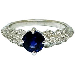 Solitaire 18 Karat White Gold Ring with Blue Sapphire and Diamonds