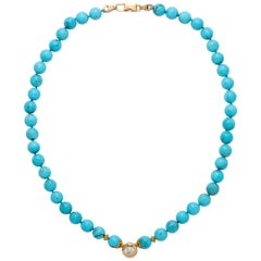 Solitaire Diamond and Sleeping Beauty Turquoise Necklace With a 14k Gold Clasp