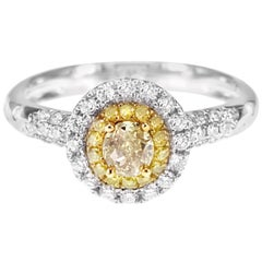 Solitaire Ring Consisting Intense Yellow and White Diamond