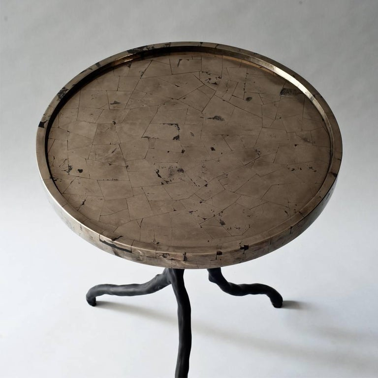 The Solstice side or end table by DeMuro Das has a tray top in Golden Pyrite, a mineral also known as