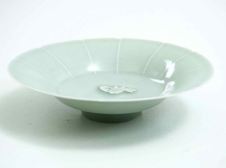 Song dynasty plate Measures: Height 4, diameter 17 cm Height 1.5, diameter 6.7 in.
