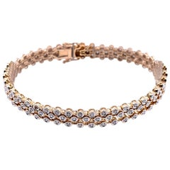 Sonia B. 14 Karat Yellow Gold Three Strand Diamond Tennis Bracelet Bezel Set