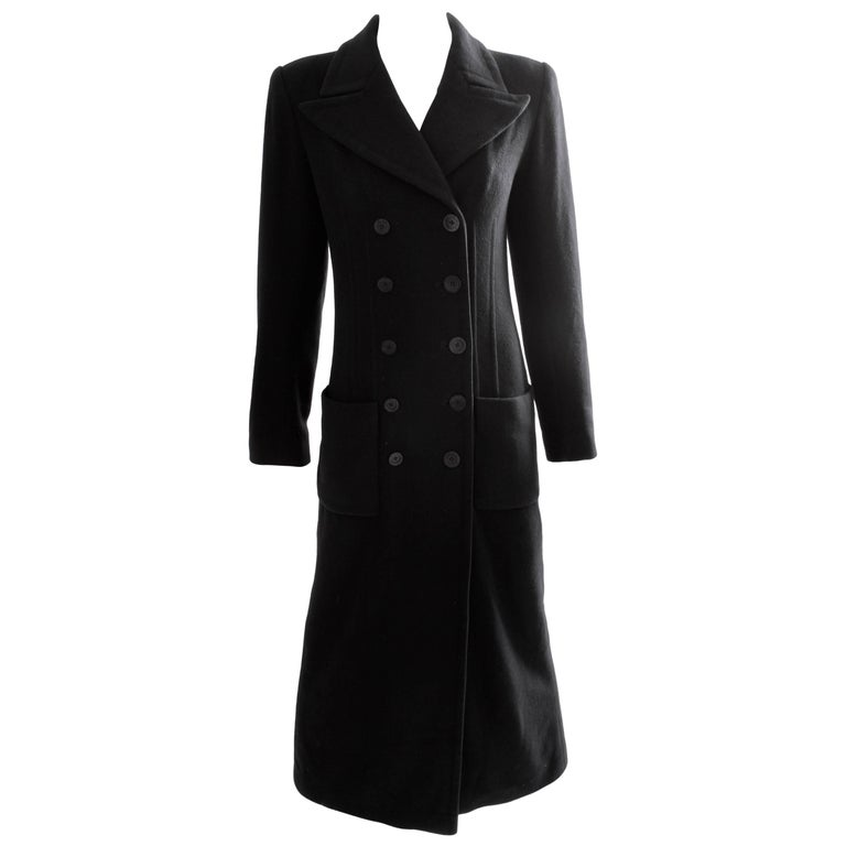 This classically-styled coat was made by Sonia Rykiel, most likely in the late 1990s.  Made from cashmere, it features double-breasted construction and is fully-lined in gray striped fabric. In excellent preowned condition with minimal signs of