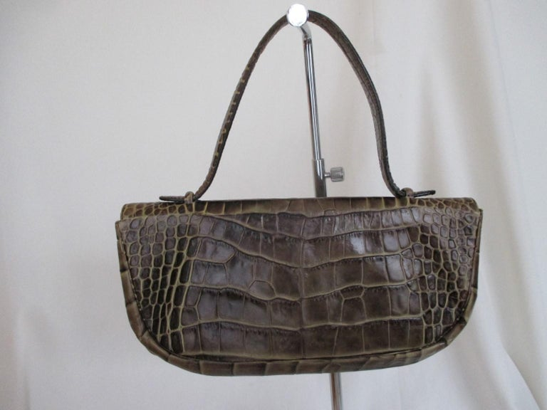 Classic vintage Sonia Rykiel embossed leather bag. - edgy and chic It closes with a magnetic press stud one pocket inside. The bag is worn has some spots inside lining and on bucket.  Dimensions aproxx:  width 29 cm/ 11.41 inch  height 14 cm/ 5.51