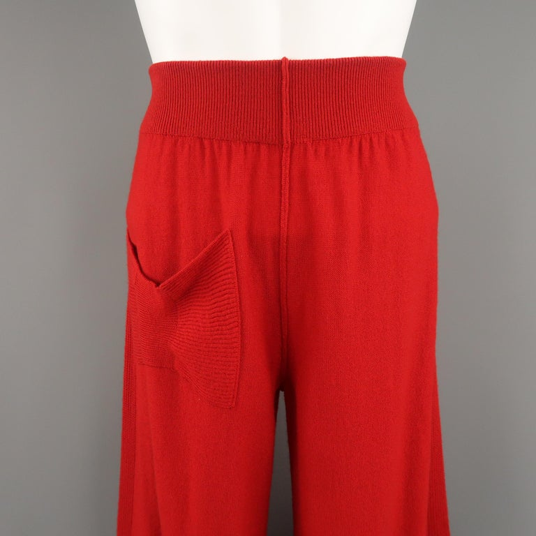 Vintage SONIA RYKIEL pants come in red cashmere wool blend knit with a high rise, thick waistband, wide leg, ribbed stripe, and bow pocket. Made in Italy.   Very Good Pre-Owned Condition. Marked: FR 38   Measurements:   Waist: 28 in. Rise: 12.5