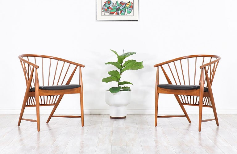 "Iconic easy modern chairs designed by Sonna Rosén for Nässjö Stolfabrik in Sweden in 1948. This early example of the ""Sun Feather"" spindle chairs was inspired by the Shaker design movement showcasing remarkable craftsmanship throughout the chair"