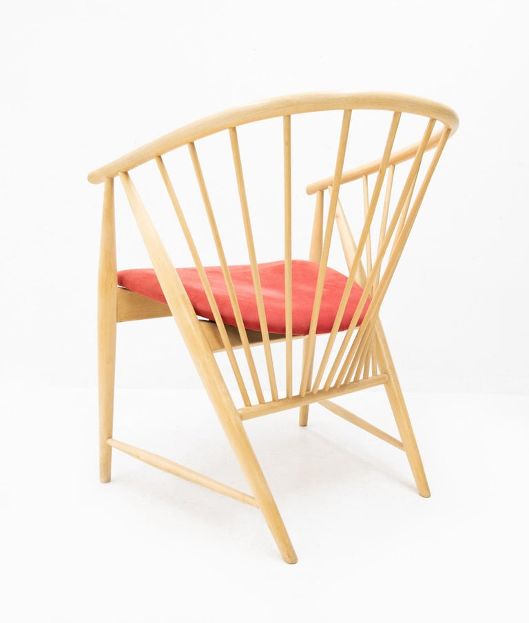 Sun feather easy chair by Sonna Rosen for Nassjo Stolfabrik Sweden 1950s sold by Pastoe. Beech wood. Comes with a red velvet upholstery. Very nice signature chair.