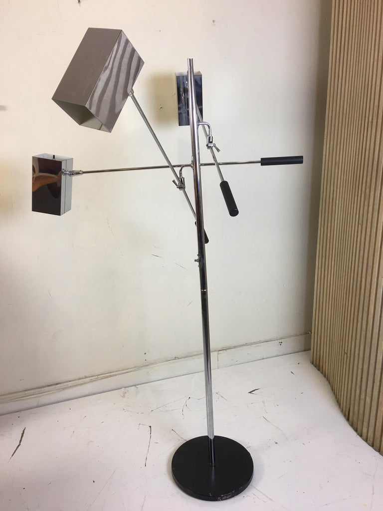 Sonneman lighting 3-arm floor lamp. Adjustable and movable square chrome shades with switches on shades and on pole. Late 1960s, early 1970s design. Each arm has a tightening mechanism which allows shades to be placed in multiple positions.