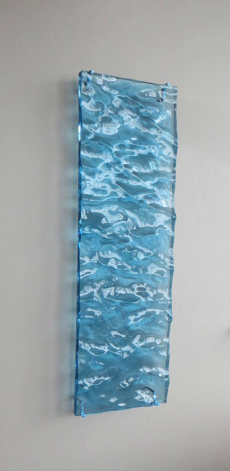 Carved Acrylic Sculpture (Blue) 48 x 15 x 2 inches Edition 1 of 5  When Collier creates a new water surface she starts with a brush that she builds with software. This brush is essentially a model of wind because wind is the source of waves in the