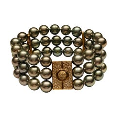 Sophisticated and Understated Triple Row Tahitian Pearl and Diamond Bracelet