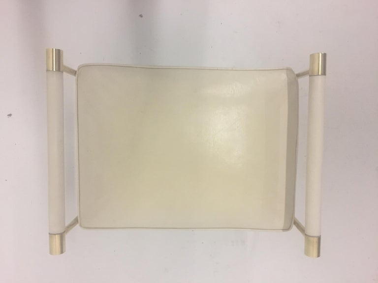 North American Sophisticated Brass Bench with Creamy Off White Leather For Sale