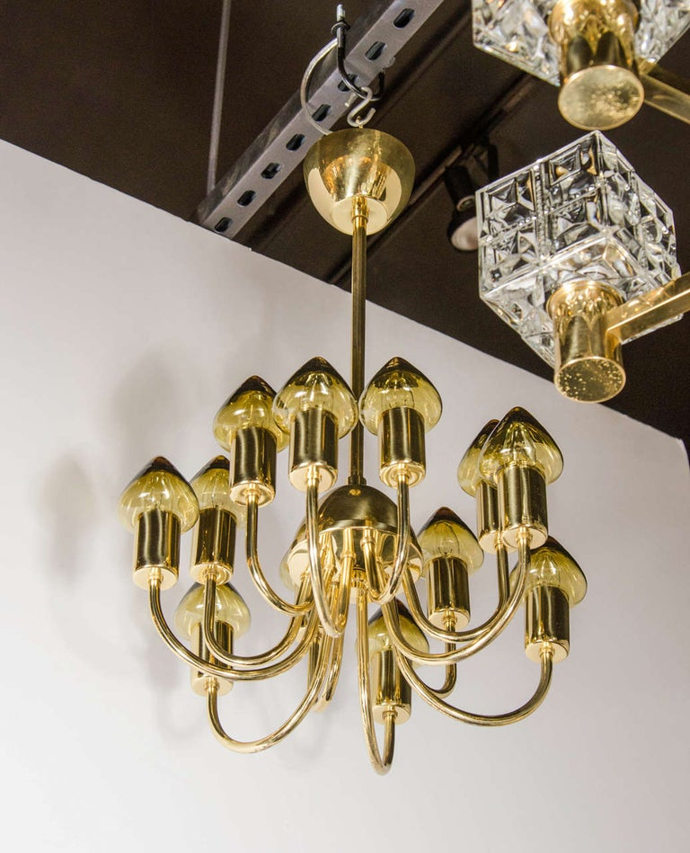 This refined Scandinavian Mid-Century Modern chandelier was realized circa 1960 by the celebrated Swedish designer Hans Agne Jakobsson. Active between 1950 and roughly 1970, often considered the
