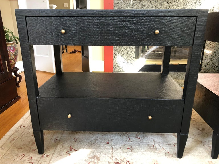 Stunning contemporary pair of black faux raffia textured nightstands having two tiers with drawers. Conrad nightstands by made goods in like new condition.