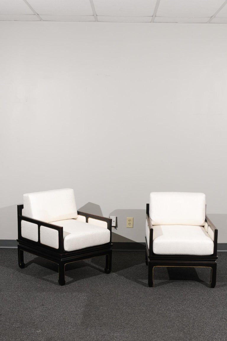 An absolutely jaw-dropping pair of meticulously restored lounge chairs from a boutique series produced by Baker Furniture, circa 1960. Extremely rare examples. Stout, expertly crafted ebonized solid mahogany construction. This elegant Asian
