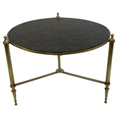 Sophisticated Round Maison Jansen Style Brass Coffee Table with Black Marble Top
