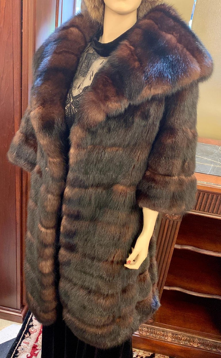 Very sophisticated and lavish, genuine regal Russian Sable fur coat features a large and very high fashion wide shawl style collar. The fur is a very rich, dark brown with beautiful shimmering lighter brown highlights - an indication of very