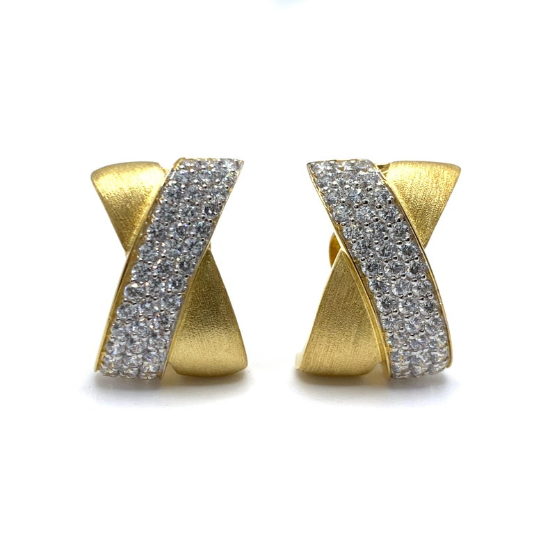 Bijoux Num's Sophisticated X-shape Pave and Vermeil Clip-on Earrings  These classic and sophisticate-style earrings feature 90pcs of round simulated diamonds pave-handset in 18k yellow gold vermeil over sterling silver, large and comfortable clip