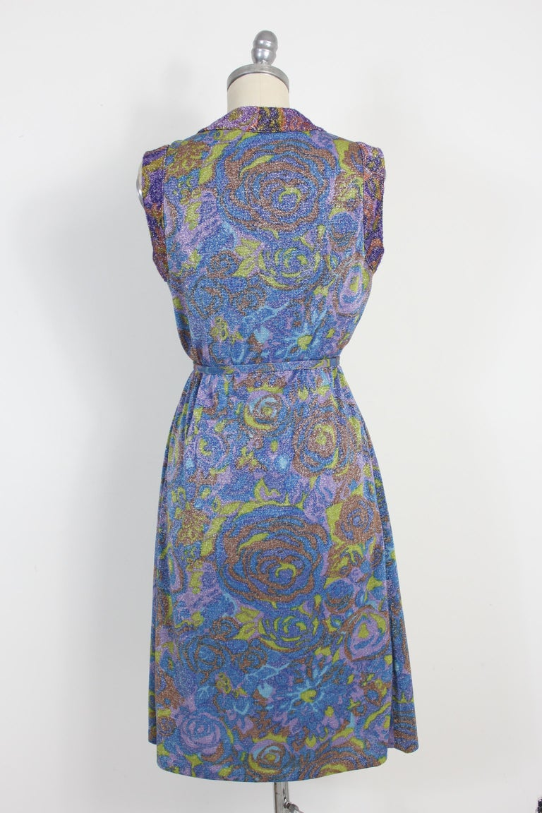 Sorelle Fontana vintage 60s blue floral laminate dress. A rare museum dress in lamé, a typical fabric from the 60s. Lamé is a type of knitted fabric with thin strips of metallic fiber, usually in gold or silver; sometimes we see the copper lamé.