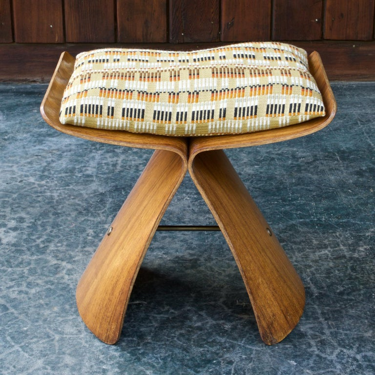 Well used 1950s butterfly stool. This stool can still be used, tested by 165 pound person, no yawning, no total crack through anywhere, just heavily worn. A wonderful time-wron piece, heavily patinated, an original survivor. Vintage pillow included.