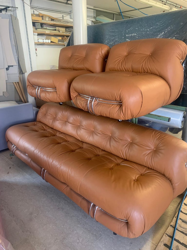 Set of one Soriana large sofa, and two lounge chairs design Tobia Scarpa for Cassina 1970s. The set is in vintage condition recovered by the previous owners about 3 years ago through their own upholsterer in a tan leather. The set is made of a large
