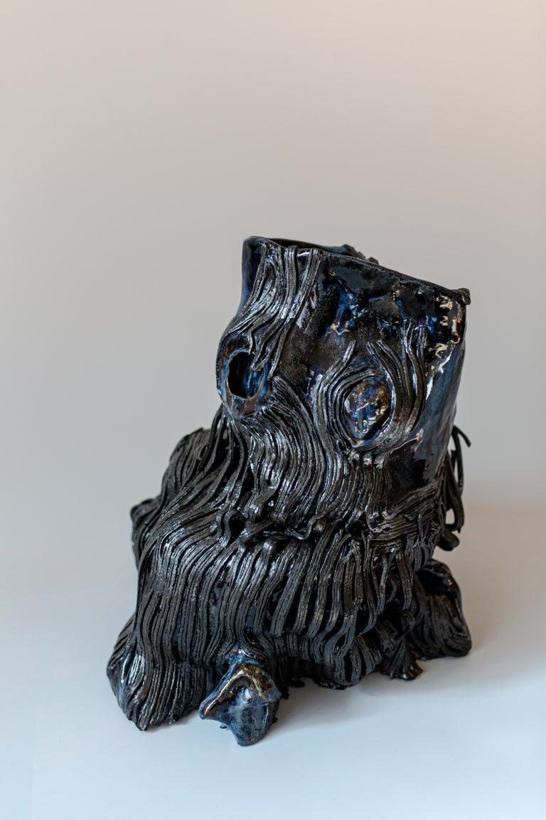 Hand-built glazed stoneware.