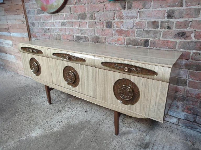 Sought after vintage retro Italian melamine sideboard with brass handles its from early 1950s. It has three drawers, cupboard space with lovely brass handles. Credenza is in very good original condition.
