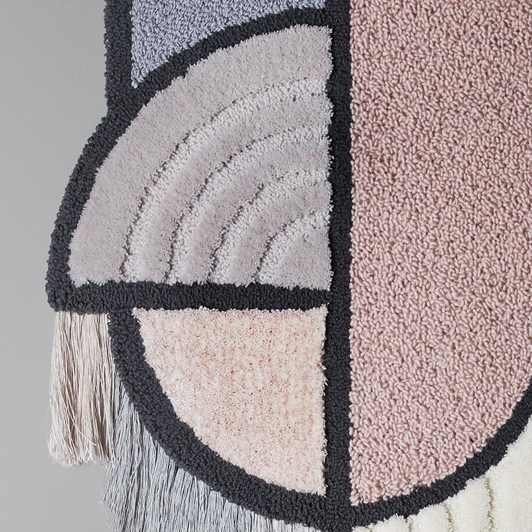 A hand tufted wallhanging in pure wool with an element of linen and fringes in 100% pure linen. As one would expect, the names derive from the semicircular (North Pole) and rectangular (South Pole) crest of blonde brass, below which bold lines of