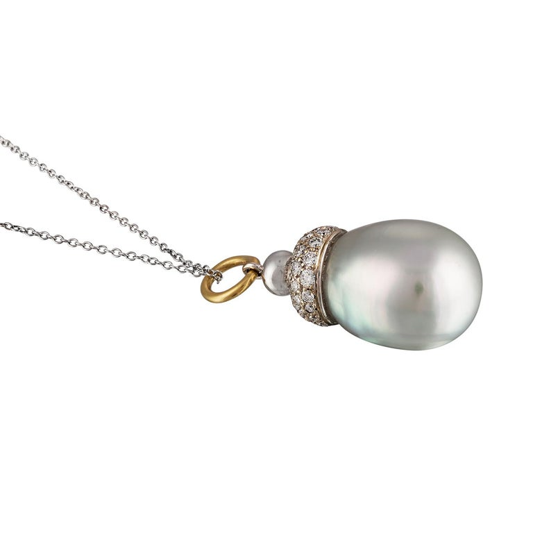 This pendant features an oversize South Sea white baroque cultured pearl measure 16.3mm with a diamond pave cap consisting of 65 diamonds set in 14 karat white gold. The South Sea pearl has excellent luster with strong silver/blue overtones.   This
