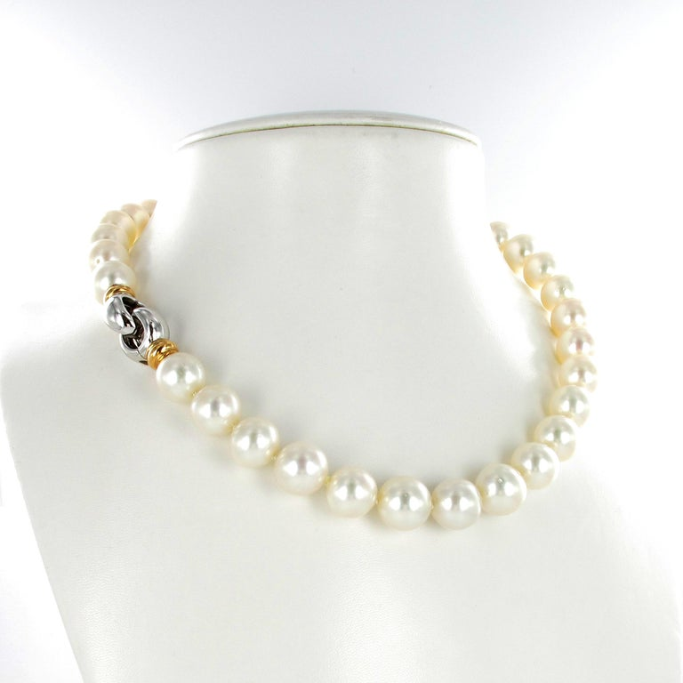This strand consists of 33 near round white South Sea cultured pearls from 13.0 mm to 13.9 mm with a very good luster. Decorated with a clasp in 18 karat white and rose gold.  Length: 48.0 cm / 18.89 Inches Maker's mark: Gubelin Assay mark: 750