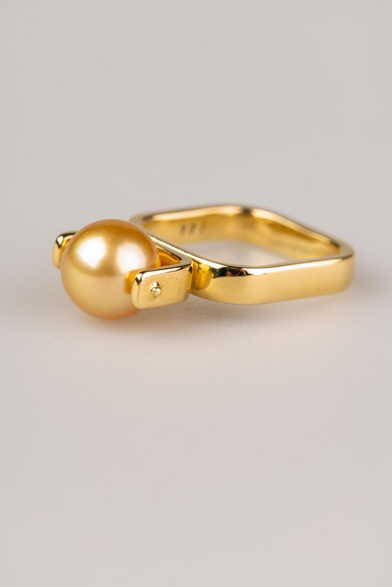 An 18k yellow gold ring with one 9mm South Sea Golden pearl. Ring size 7. This ring was made and designed by llyn strong.