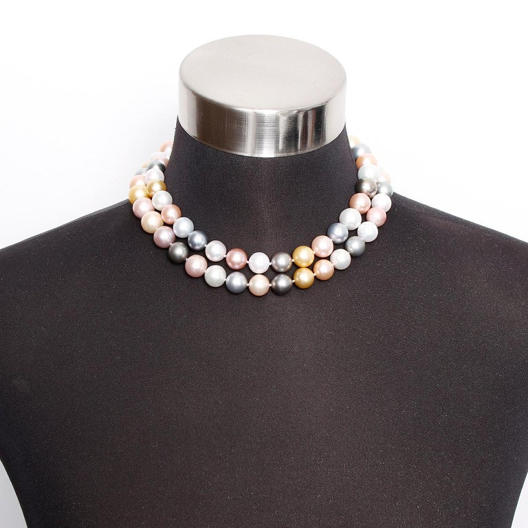 South Sea Multicolor Peal Necklace with Diamond Clasp 33 inches - . This elegant multicolored pearl necklace features natural, unenhanced pearls from all over the world ranging in size from 11.2 to 14.9 mm. The white Pearls are from Australia, pink