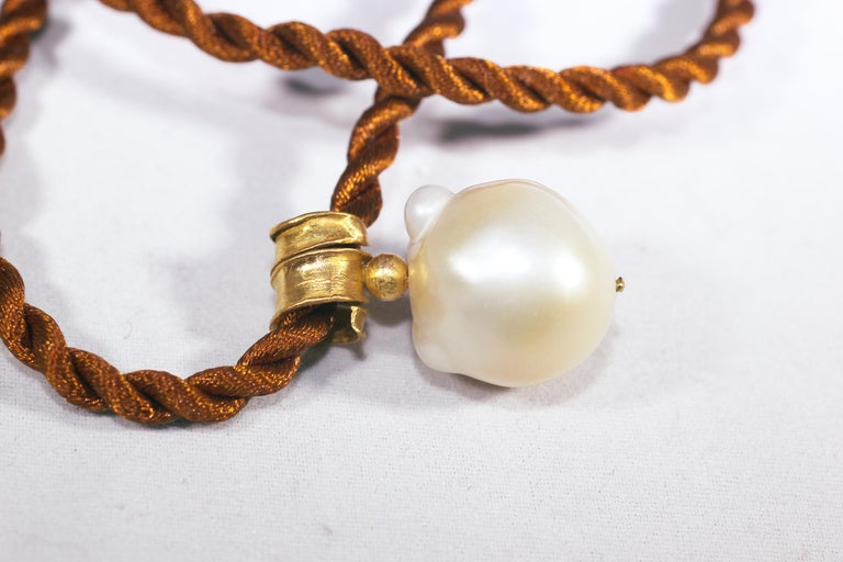 In The Sea South Sea pendant. Made to order, custom-made hand-formed choker pendant necklace. White Baroque South Sea pearl hangs off of organically shaped bail hand forged of 21K gold. No two necklaces are identical.   The inspiration for this