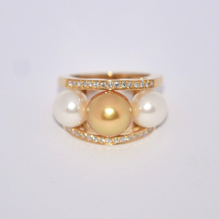 Discover this South Sea Pearl and White Diamonds on Yellow Gold 18 Karat Fashion Ring. Gold South Sea Pearl 10 mm South Sea Pearl 8 mm White Diamonds 0.3 Karat Yellow Gold 18 Karat French Size 53 US Size 6.5