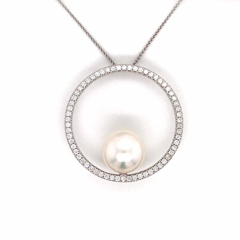 18K White gold pendant featuring one South Sea Pearl measuring 13-14 mm with a diamond circle containing 62 round brilliants weighing 1.04 carats.  Color G-H Clarity SI  Pearl can be changed to a Pink, Golden or Tahitian Pearl upon request. Price